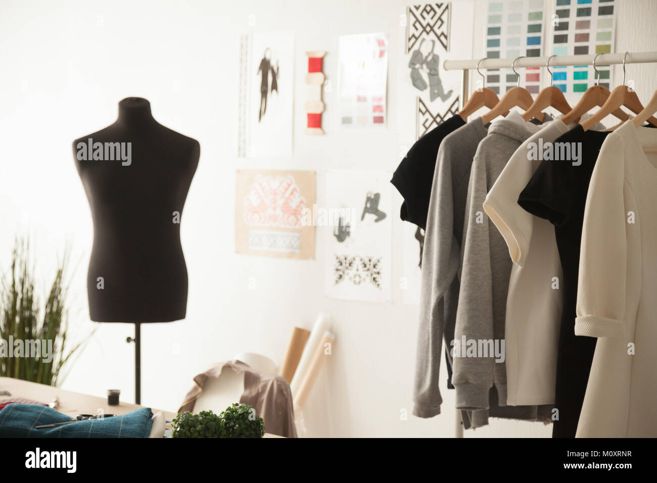 Fashion design cozy studio interior with dummy, dressmaking and  - Stock Image