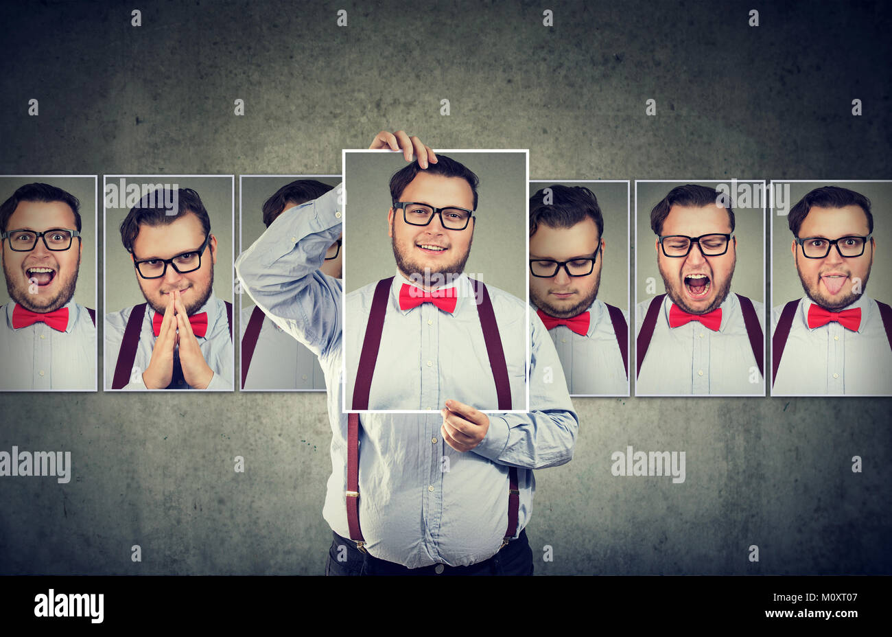 Chubby man with split personality choosing mood and hiding real feelings. - Stock Image