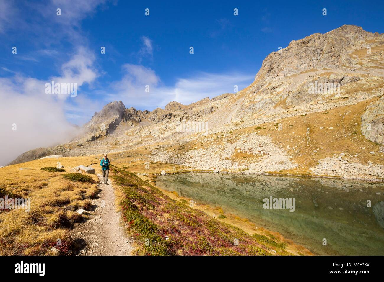 France,Alpes-Maritimes,Mercantour National Park,Gordolasque Valley,hiker walking by lake Autier (2275m) Stock Photo