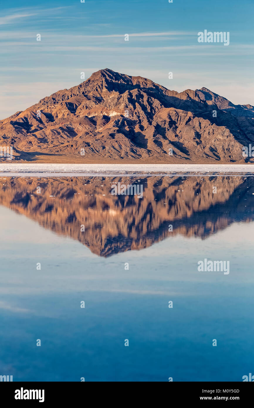 Silver Island Range reflecting in salty water at the Bonneville Salt Flats, which is BLM land west of the Great Stock Photo