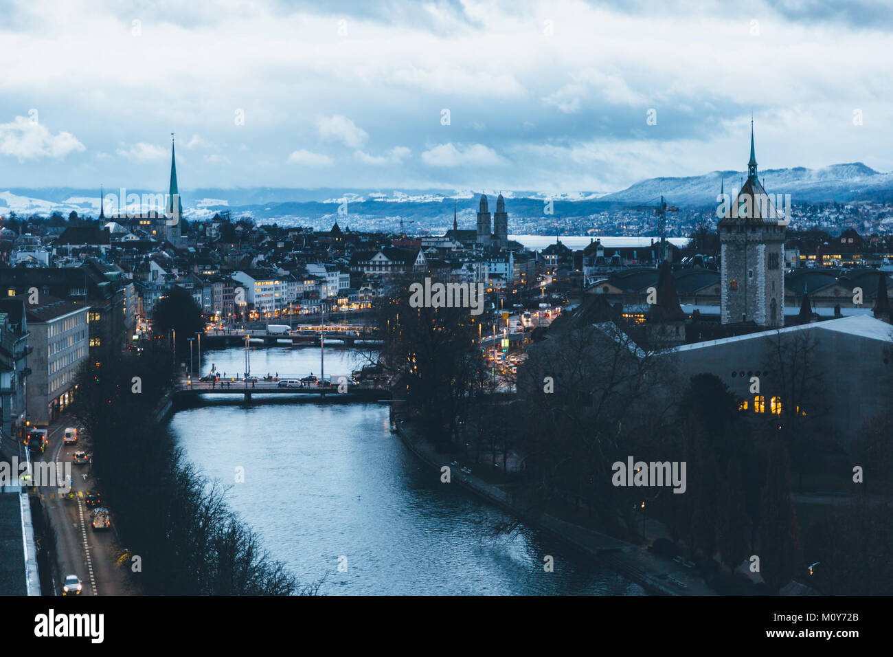 Aerial view of Zurich city center at dawn, with the Limmat river in the foreground and the old town in the background. - Stock Image