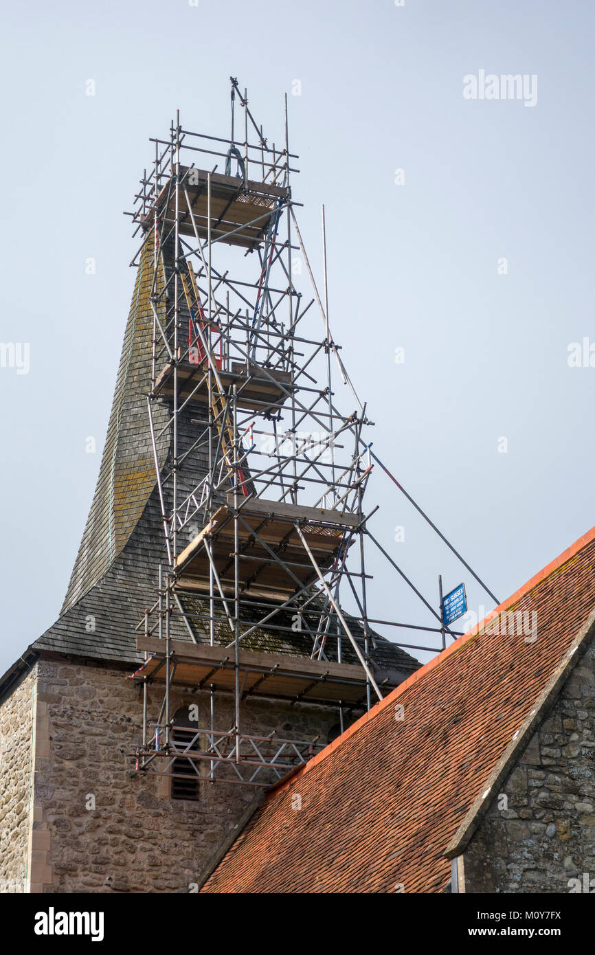 Scaffolding on a church tower, The Priory Church of St. Mary, Hayling Island, Hampshire, UK - Stock Image