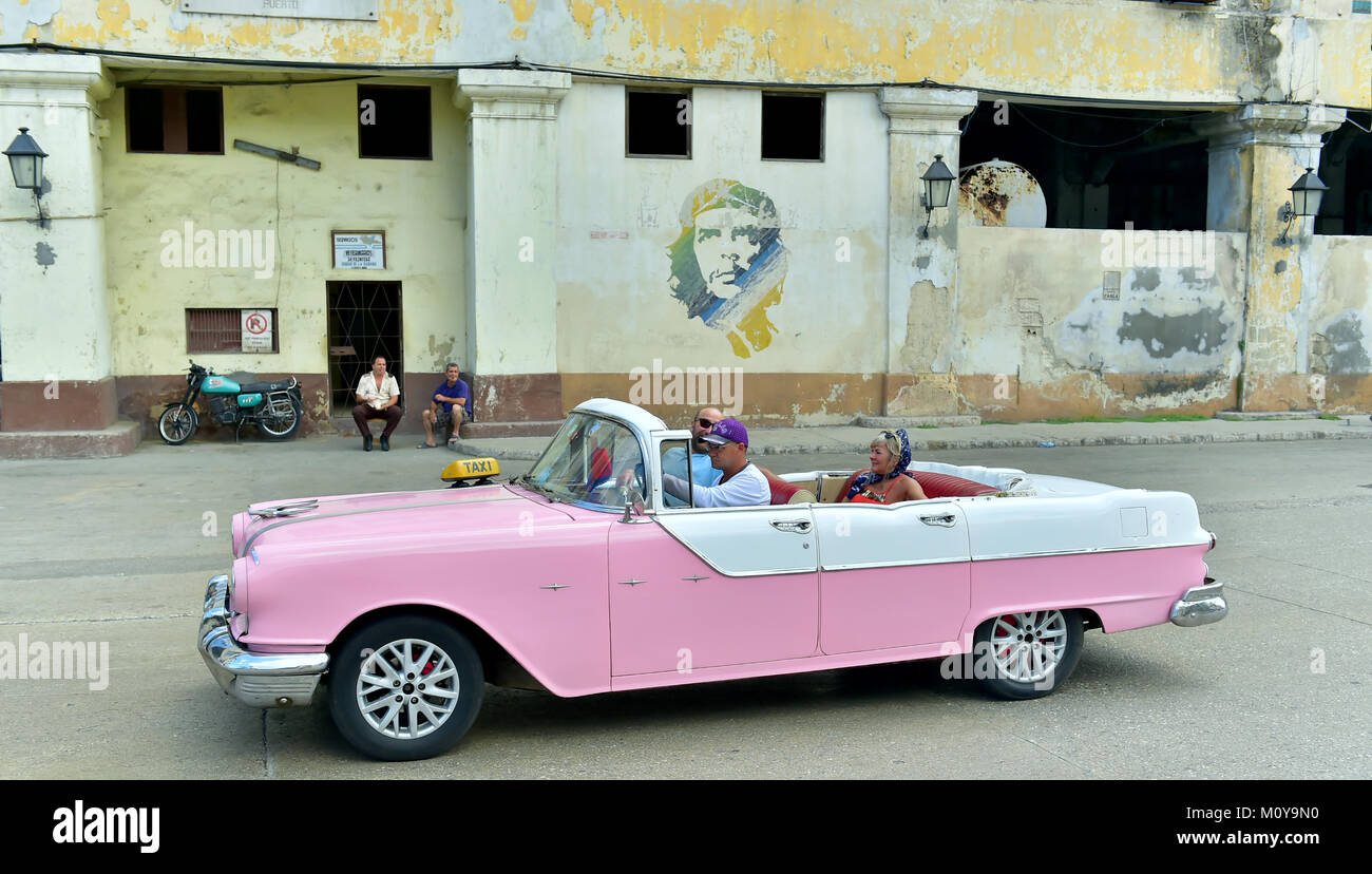 Old classic cars used a taxis circulating on a well known street in ...