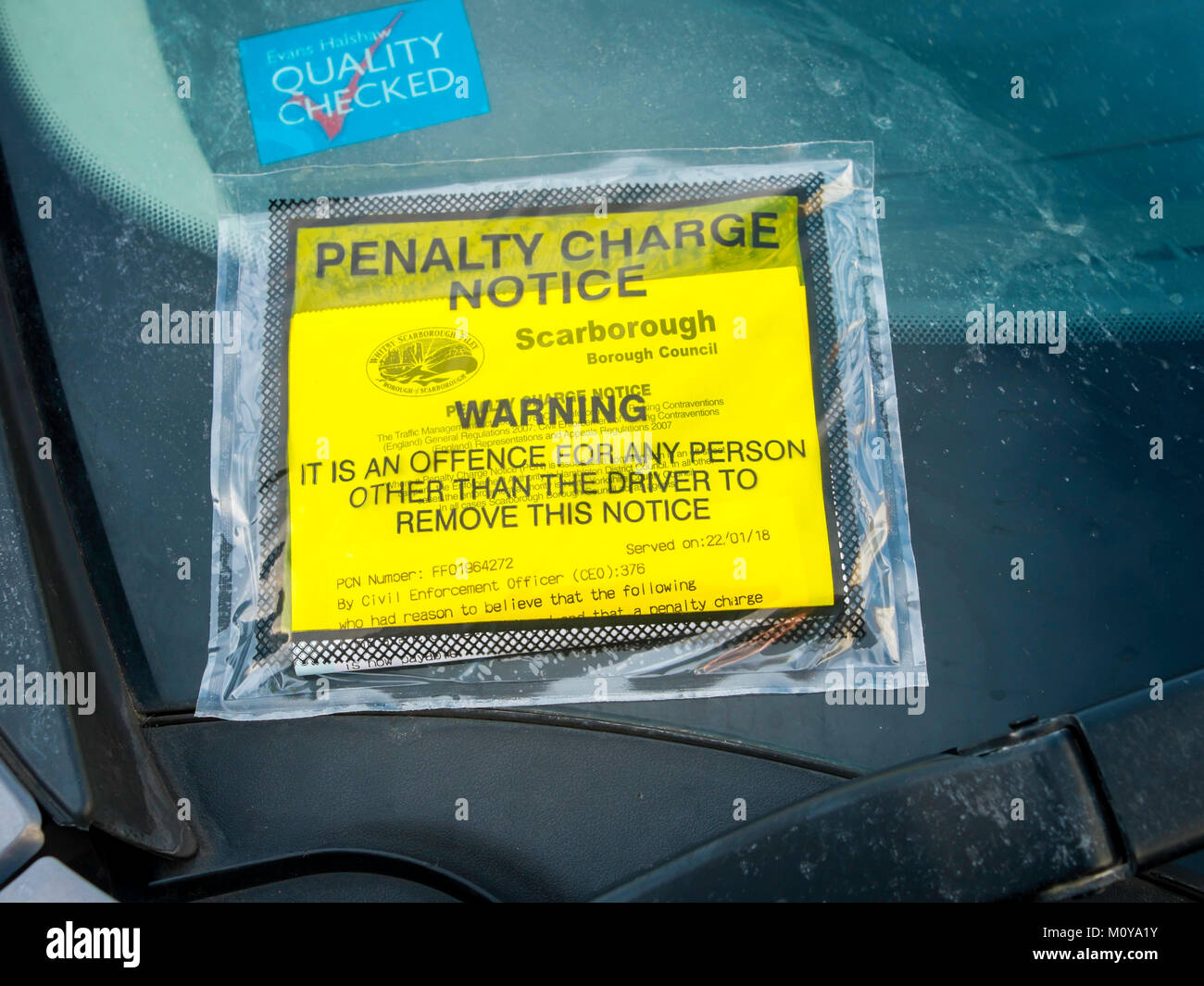 Penalty Charge Notice on a car that has failed to display a valid  paid parking ticket issued by  Scarborough Borough - Stock Image