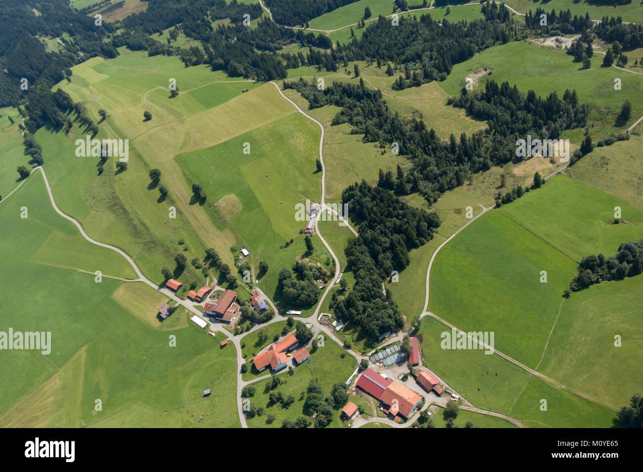Aerial view of farmhouses around Schober 6, 87642 Halblech, Bavaria, Germany - Stock Image