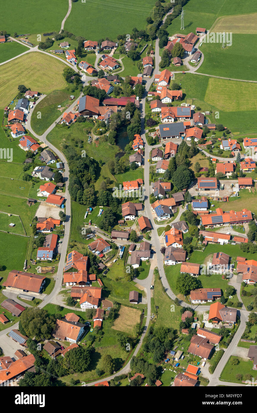 Aerial view of houses with solar panels in Urspring 86989 Steingaden, Bavaria, Germany - Stock Image