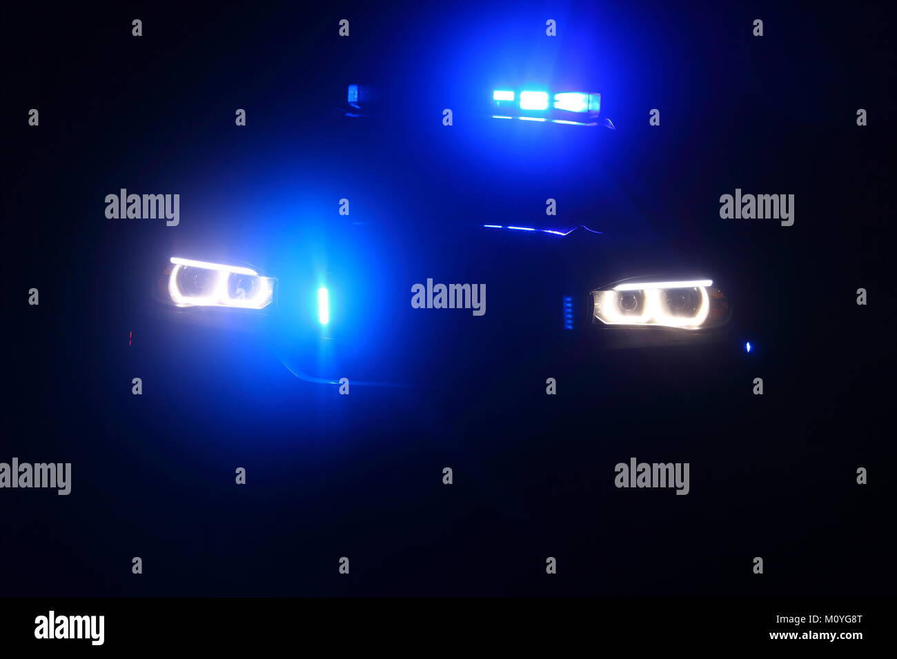 Abstract blue lights on a BMW X5 police car in Doncaster, South Yorkshire. Stock Photo