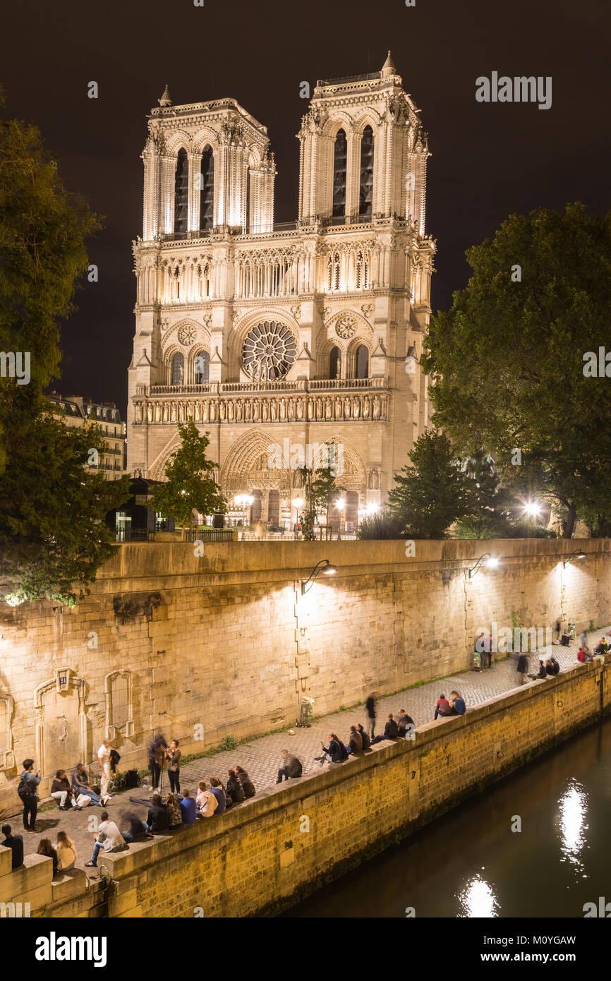 Cathedral Notre Dame de Paris at night,side view,front Seine,Paris,France - Stock Image