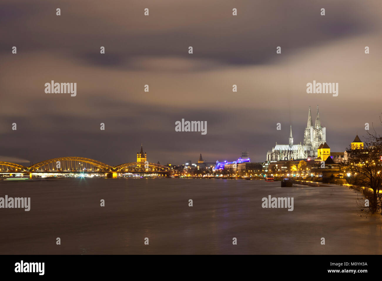 Germany, Cologne, high tide of the river Rhine, flooded promenade, view to the cathedral and the Hohenzollern bridge. - Stock Image