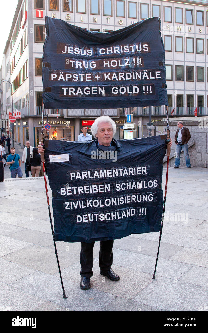 Germany, Cologne, demonstrator in front of the cathedral (translation: jesus wears wood. popes and cardinals wears - Stock Image