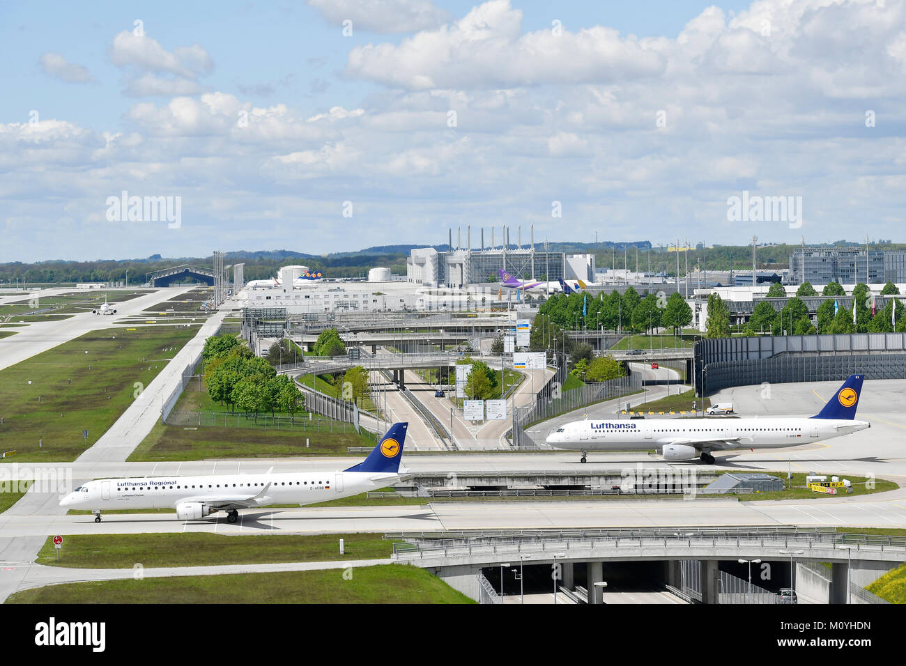 Lufthansa (Embraer ERJ-195LR and Airbus A321),passenger aircraft taxiing to runway,Munich Airport,Upper Bavaria,Germany - Stock Image