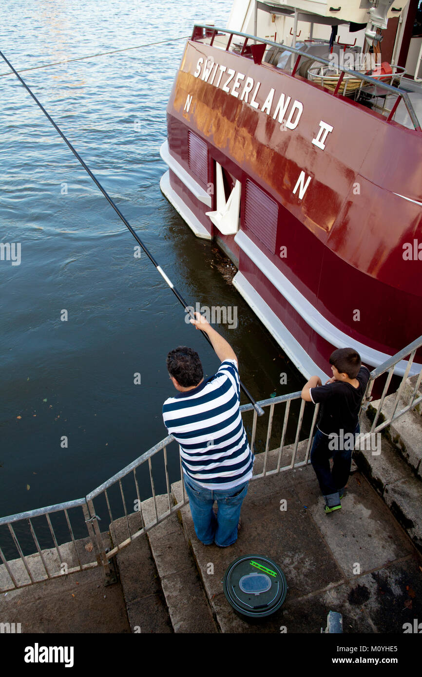 Germany, Cologne, fisherman at the river Rhine.  Deutschland, Koeln, Angler am Rheinufer. - Stock Image