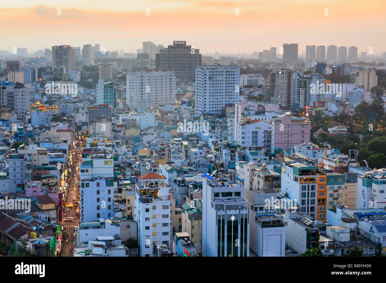 Skyline of Ho Chi Minh City with Bui Vien street in the foreground, taken at sunset Stock Photo