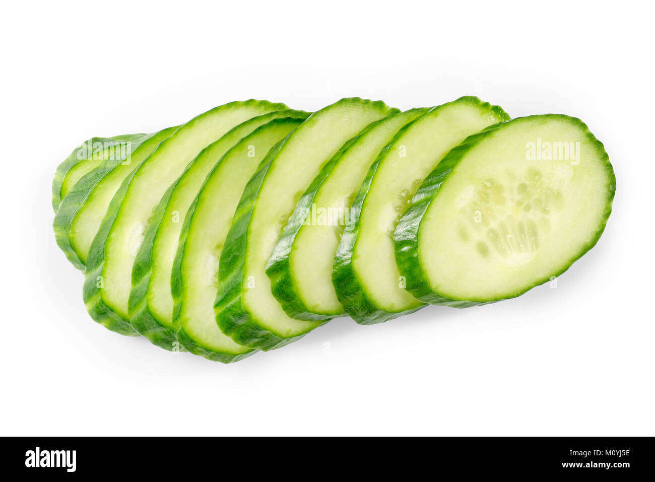 Green cucumber slices isolated on white - Stock Image