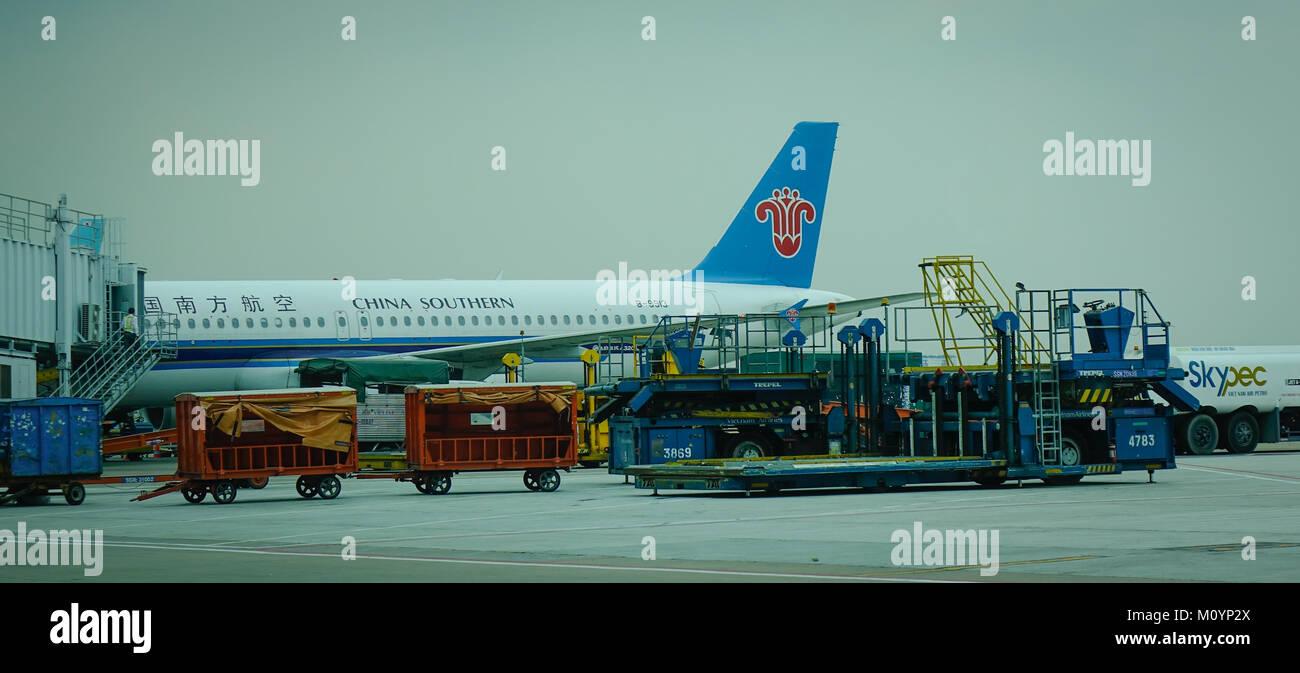 Saigon, Vietnam - Mar 28, 2017. A civil aircraft docking at Tan Son Nhat Airport in Saigon, Vietnam. Tan Son Nhat - Stock Image