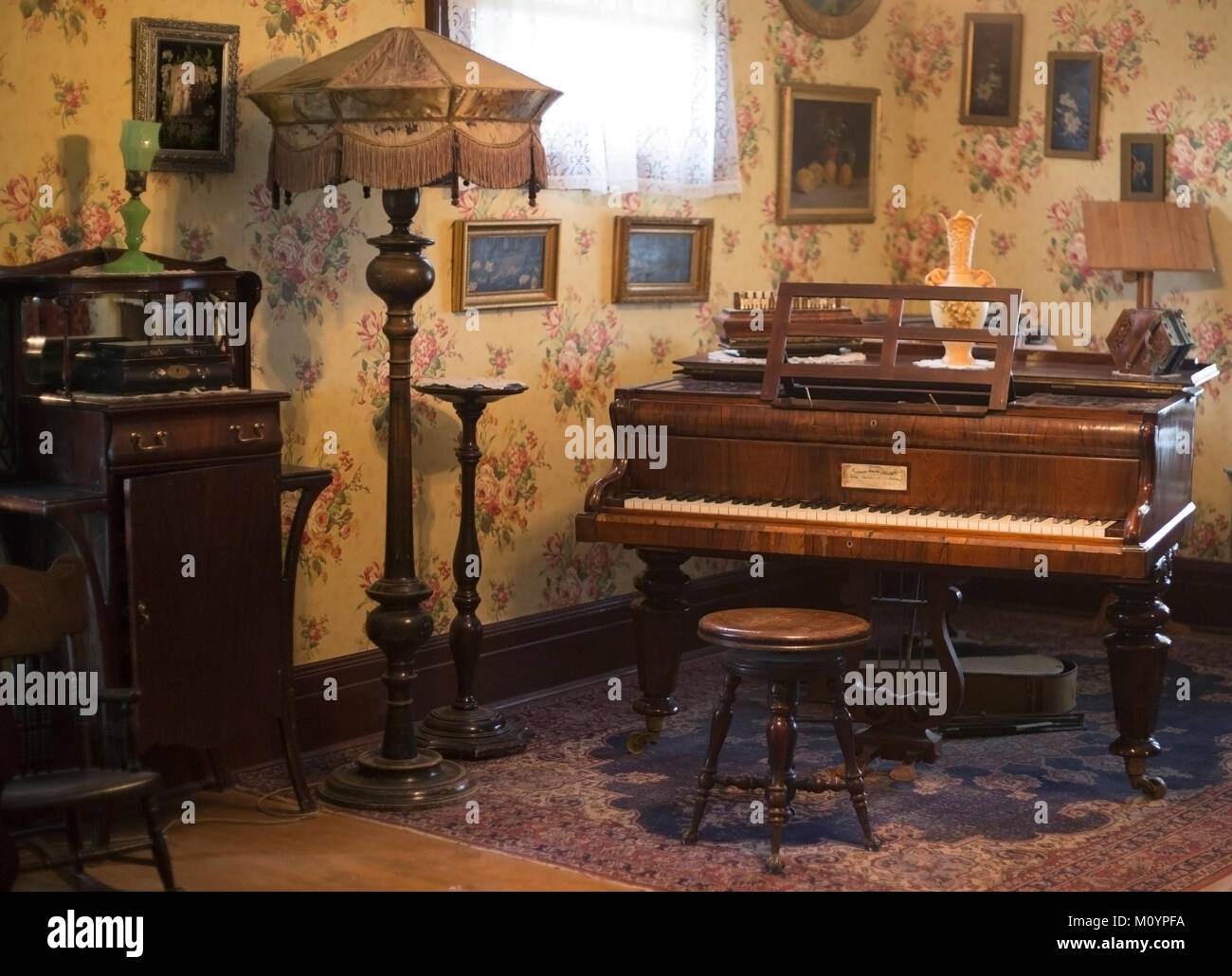 Piano room in the Thorpe House, Victorian house built in 1886, now restored in Heritage Park Historical Village - Stock Image