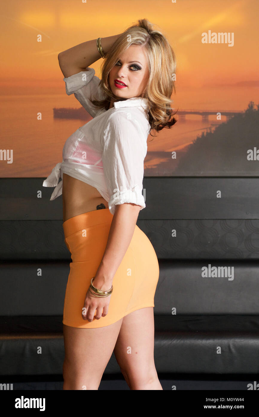 b9e4ccfd5 Beautiful blonde girl wearing an orange mini-skirt Stock Photo ...