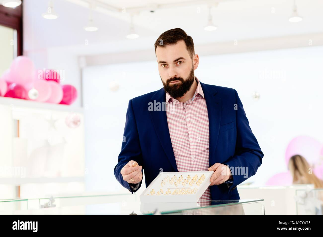 Attractive Man With A Beard Showing A Collection Of Wedding