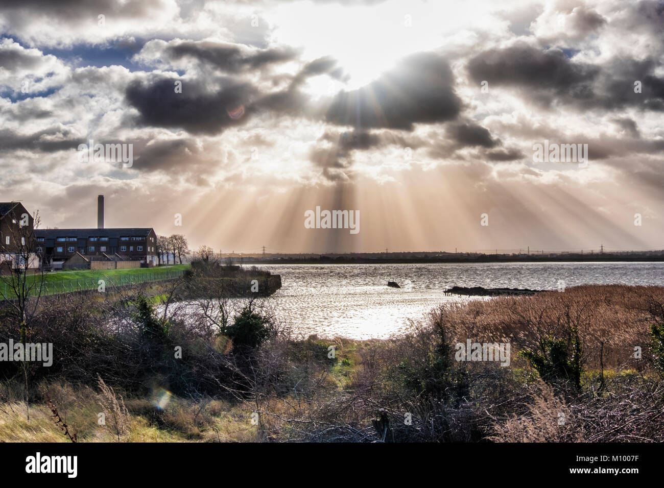Essex,UK. View from Rainham Marshes RSPB nature reserve next to Thames Estuary in Purfleet,Thames river, clouds - Stock Image
