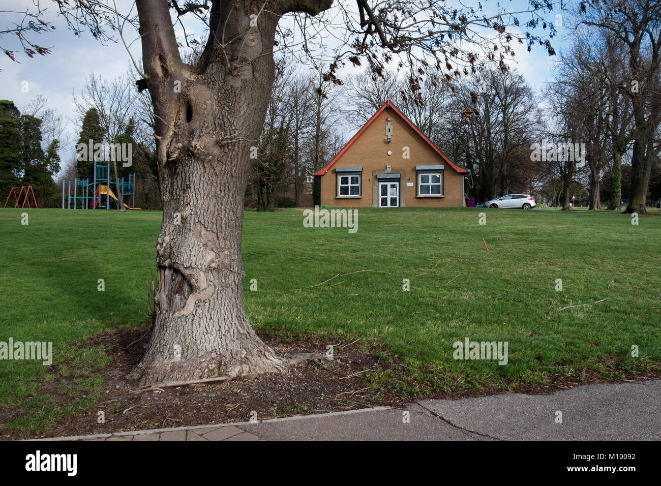 Essex,UK. West Thurrock Children's Centre Purfleet with playground with swings & slide. - Stock Image