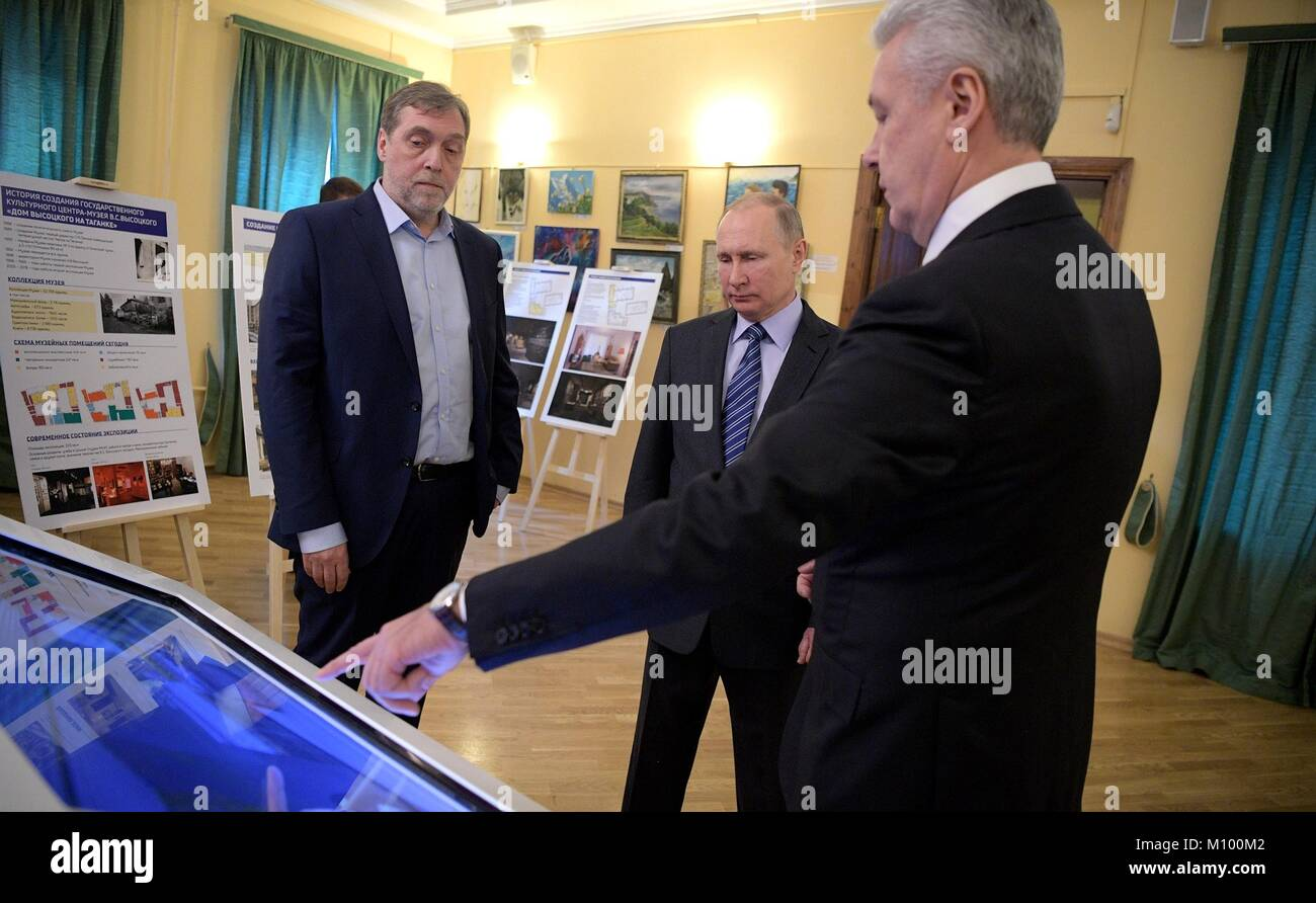 Russian President Vladimir Putin, center, tours the Vysotsky House and Taganka Museum Centre with Museum Director - Stock Image