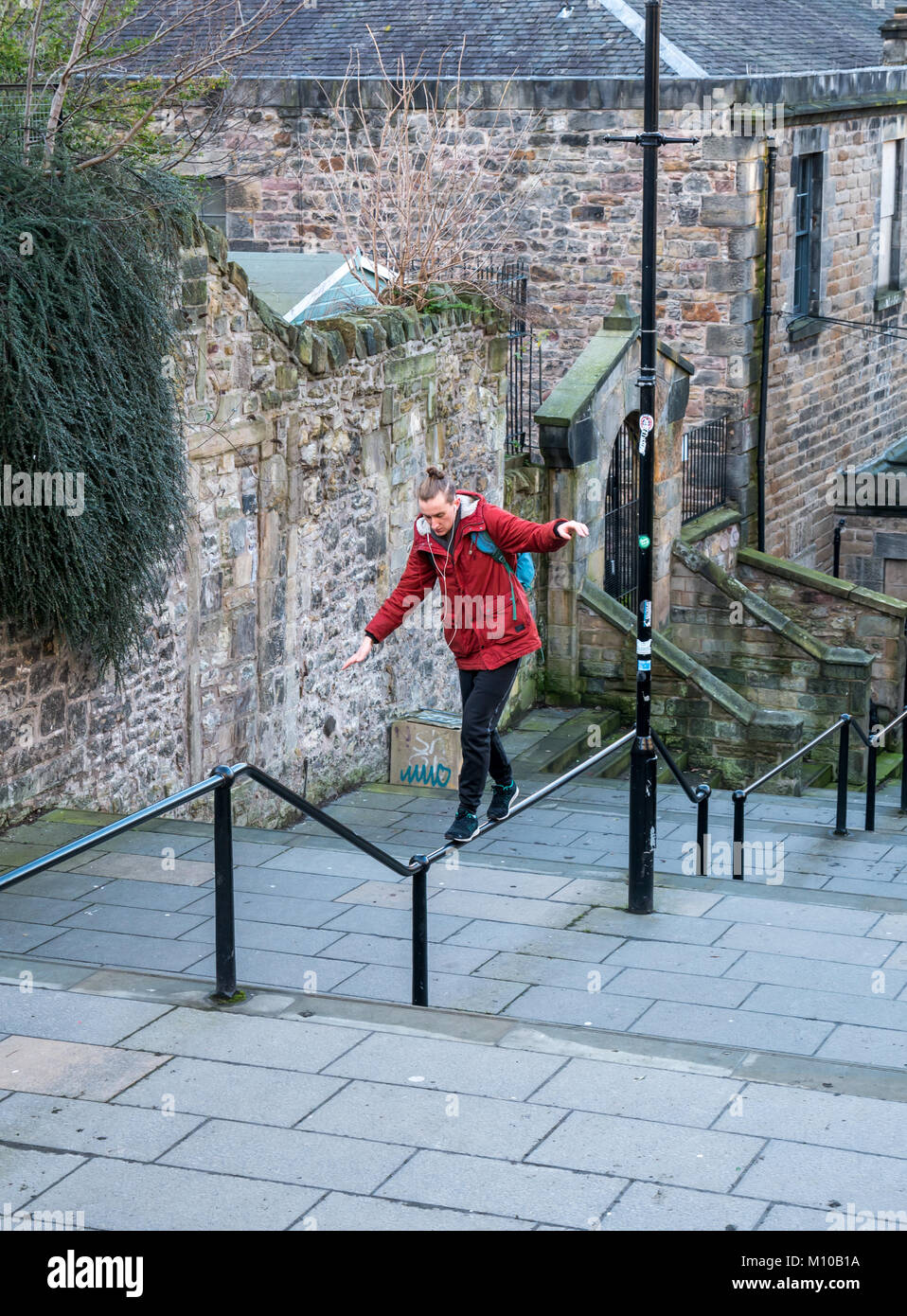 Vennel, Grassmarket, Old Town, Edinburgh, Scotland, United Kingdom, 24th January 2018. Young man practising balancing Stock Photo