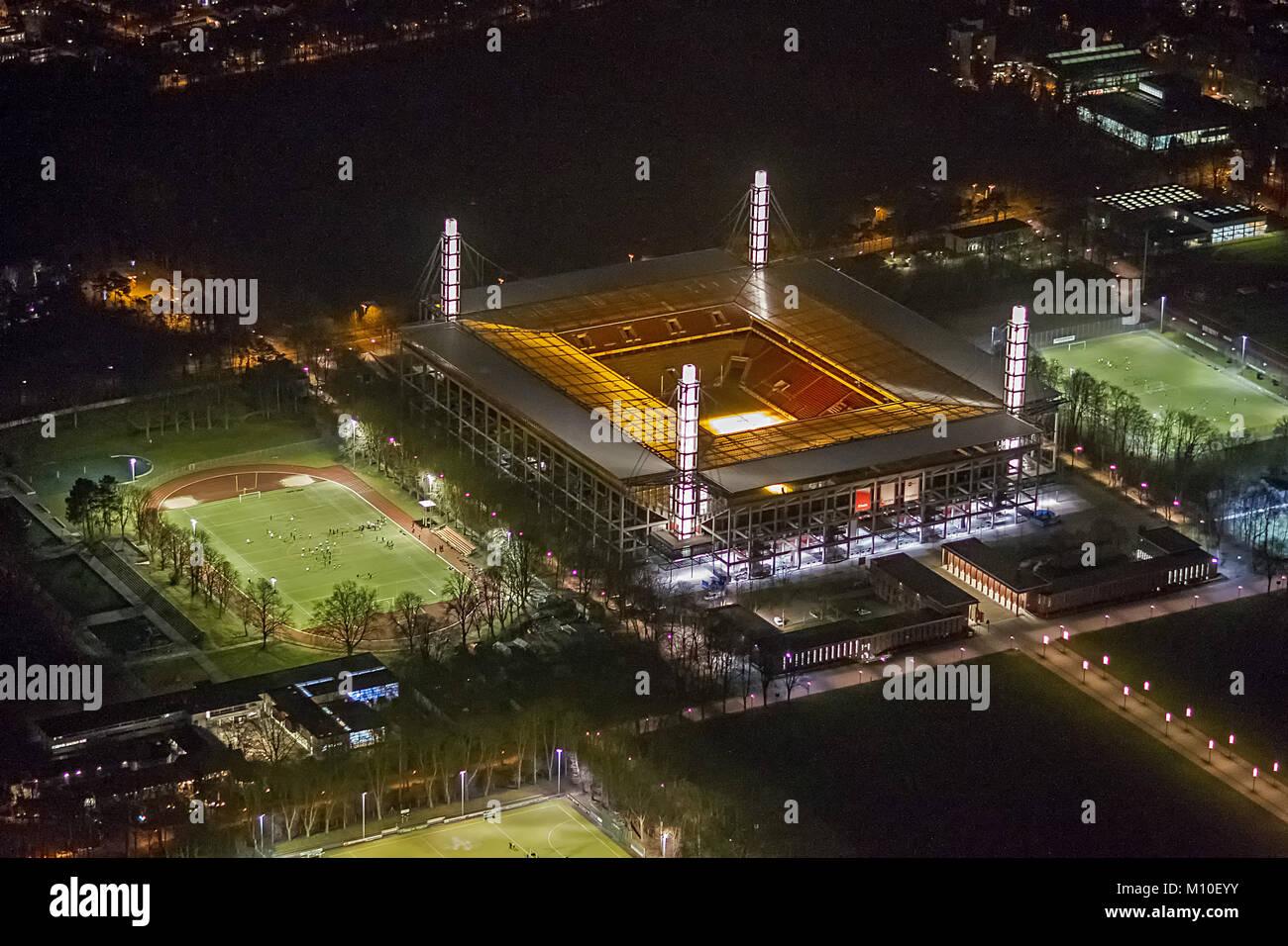 Luftbild, RheinEnergieStadion, Müngersdorfer Stadion, 1. FC Köln , Bundesligastadion bei Nacht, Nachtaufnahme, - Stock Image