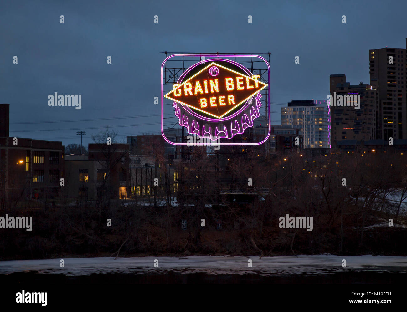 The iconic 1941 Grain Belt Beer sign in shades of neon purple in Minneapolis, Minnesota - The color purple is to - Stock Image