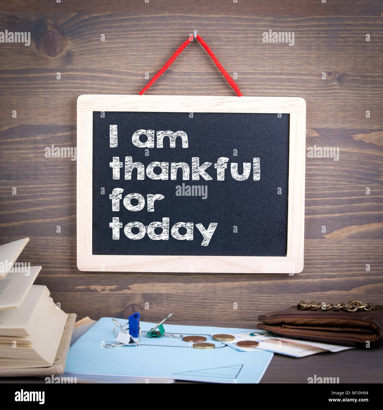 I am thankful for today. Chalkboard on a wooden background - Stock Image