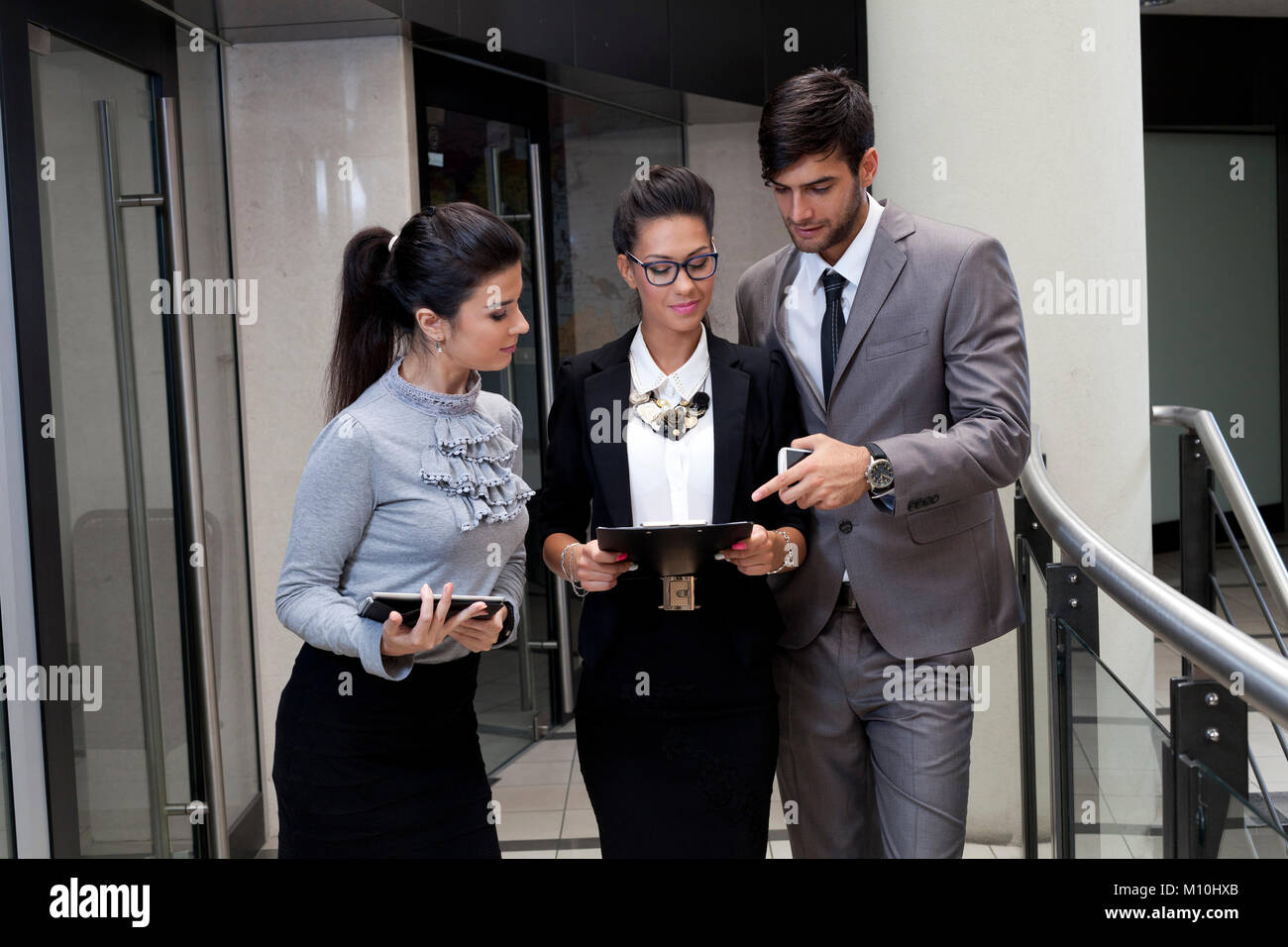 Professiona young  business people neer office - Stock Image