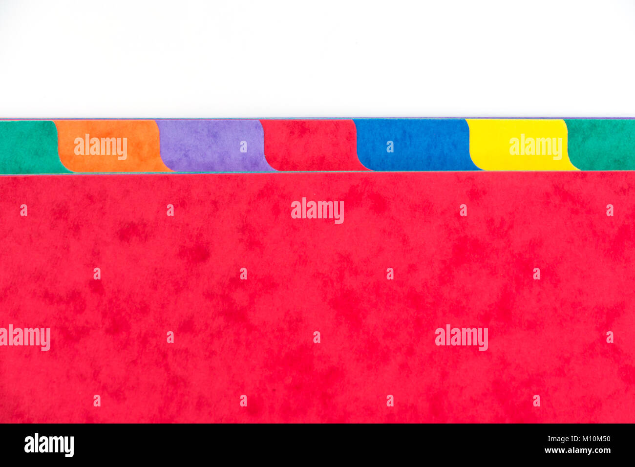Photo of colorful folder dividers with copy space, white background - Stock Image