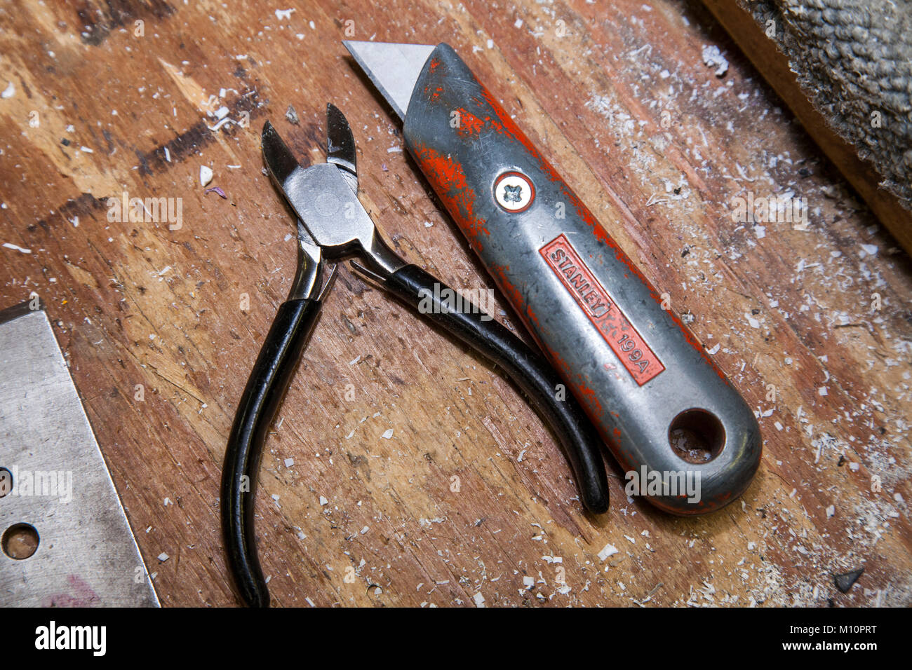 Fine Snips Pliers And A Stanley Knife Craft Knife On A Wooden Gamerscity Chair Design For Home Gamerscityorg