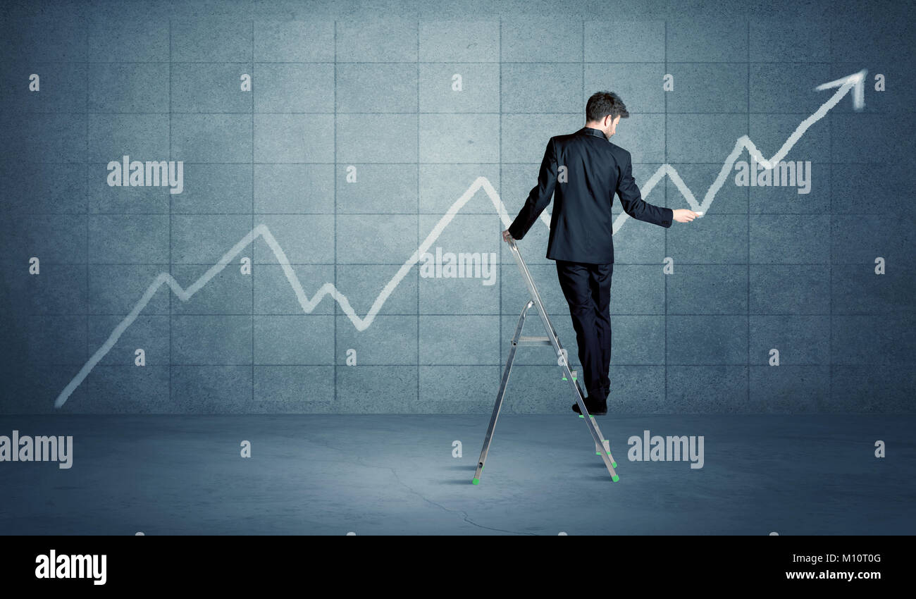 A man standing on a ladder and drawing a chart on blue wall background with exponential progressing curve, line - Stock Image
