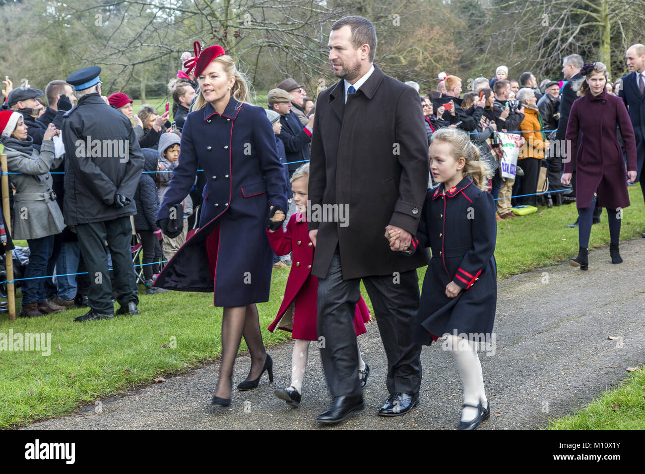 The British Royal family arrive at Sandringham to celebrate Christmas Day  Featuring: Autumn Phillips, Peter Phillips - Stock Image