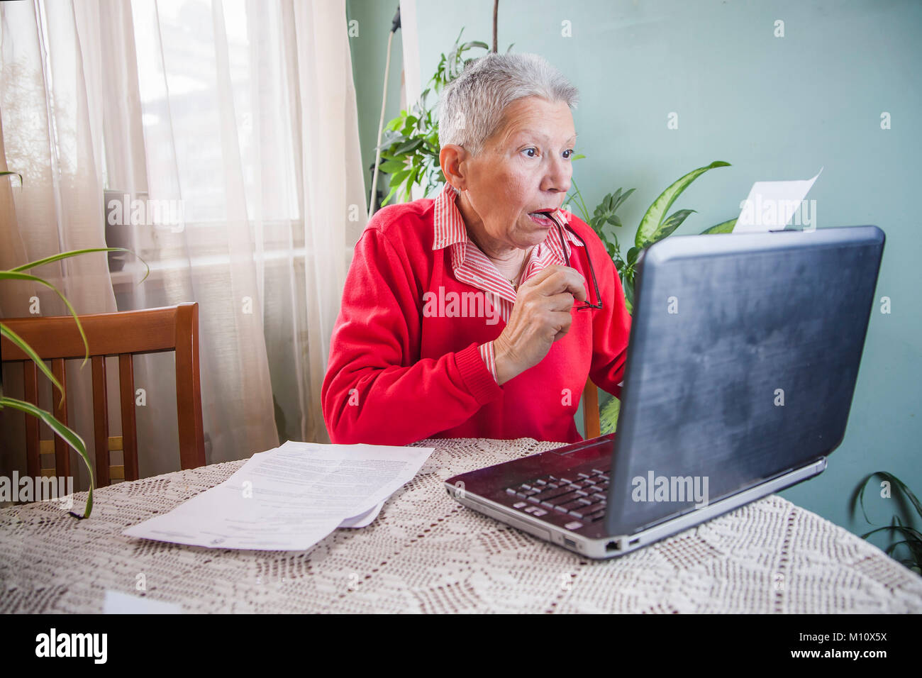 Shocking amount of money an old woman has to pay for her bills - Stock Image
