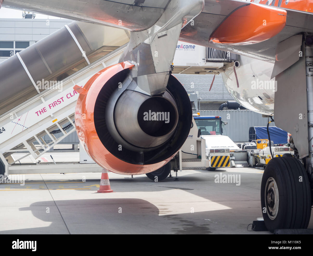 Krakow, Poland - June 6, 2017: Exhaust of the Rolls_Royce  jet engine, pylon, wing , landing gear of Airbus a320 - Stock Image