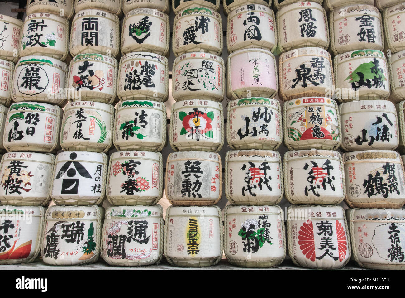 Barrels of sake wrapped in straw Stock Photo