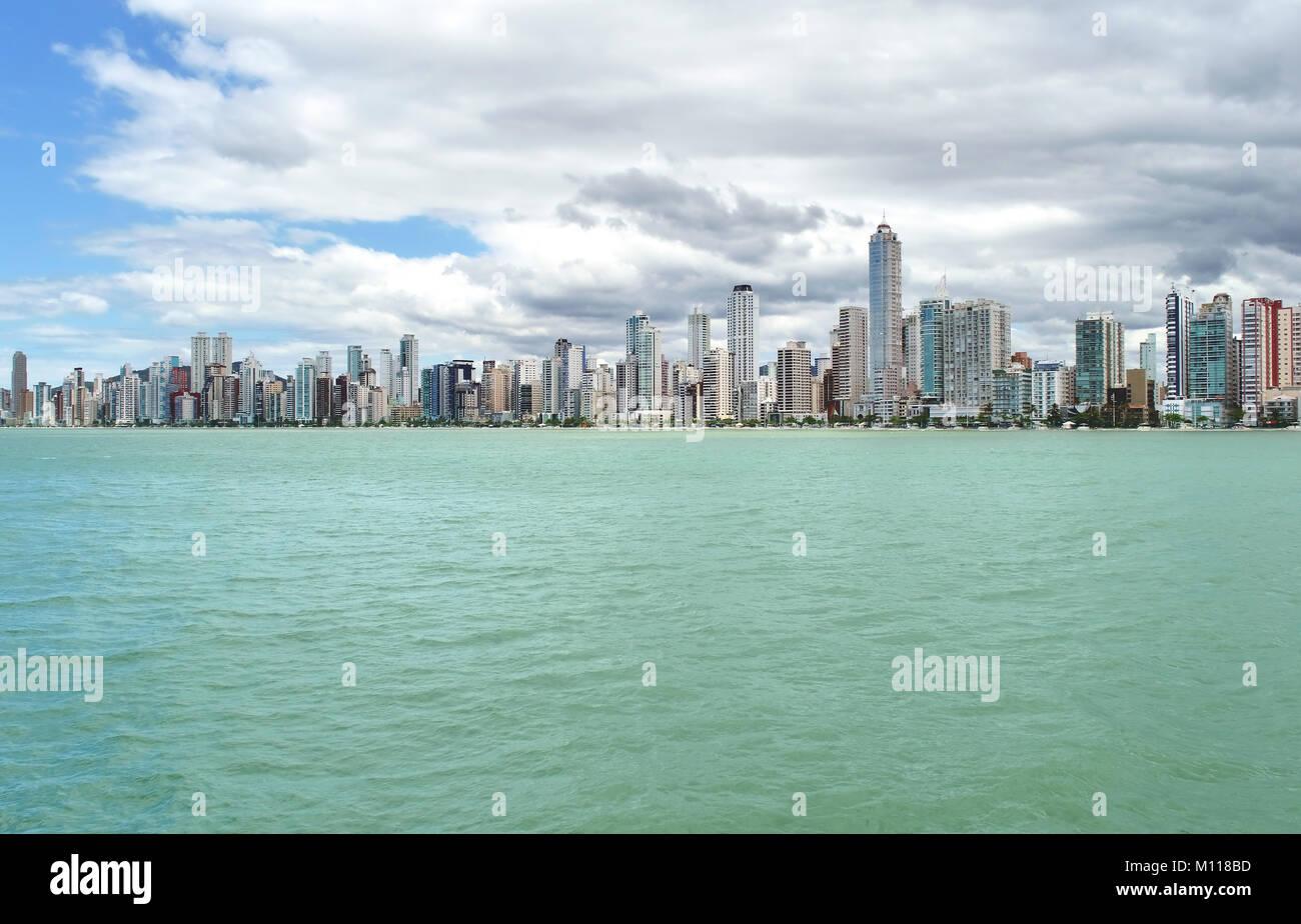 Cityscape of Balenario Camboriu, SC/ Brazil seen from the sea - Stock Image