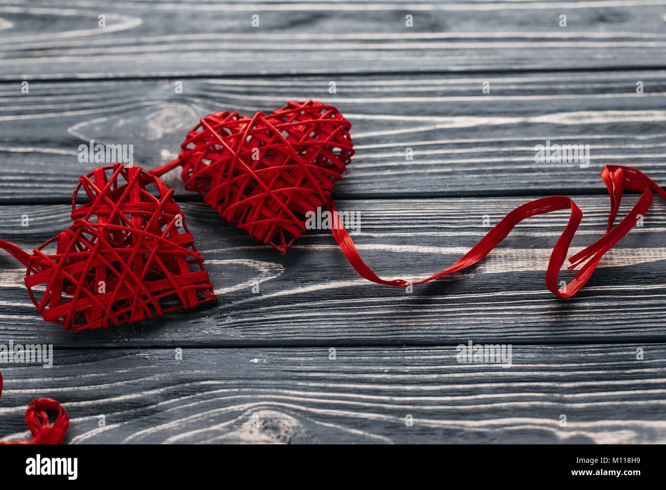 Stylish Two Red Hearts Ribbons On Black Rustic Wooden Background Happy Valentines Day Concept