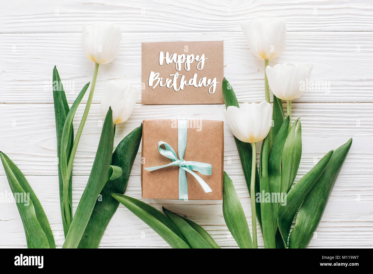Happy Birthday Text Sign On Greeting Card With Stylish Present Box And Tulips White Wooden Rustic Background Flat Lay Mock Up Flowers Emp
