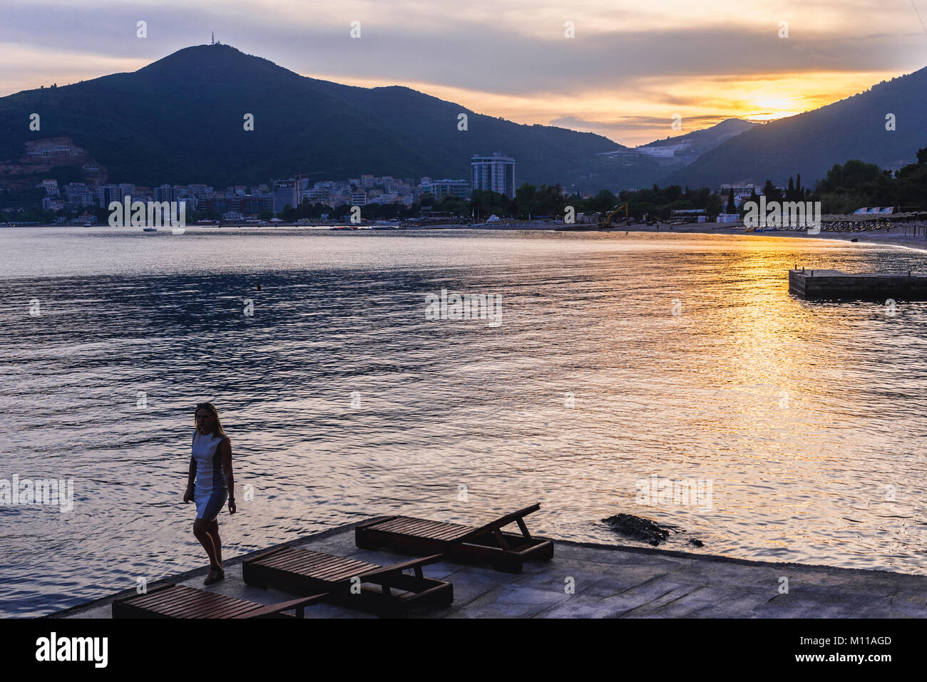 Sunset in Budva city on the Adriatic Sea coast in Montenegro - Stock Image