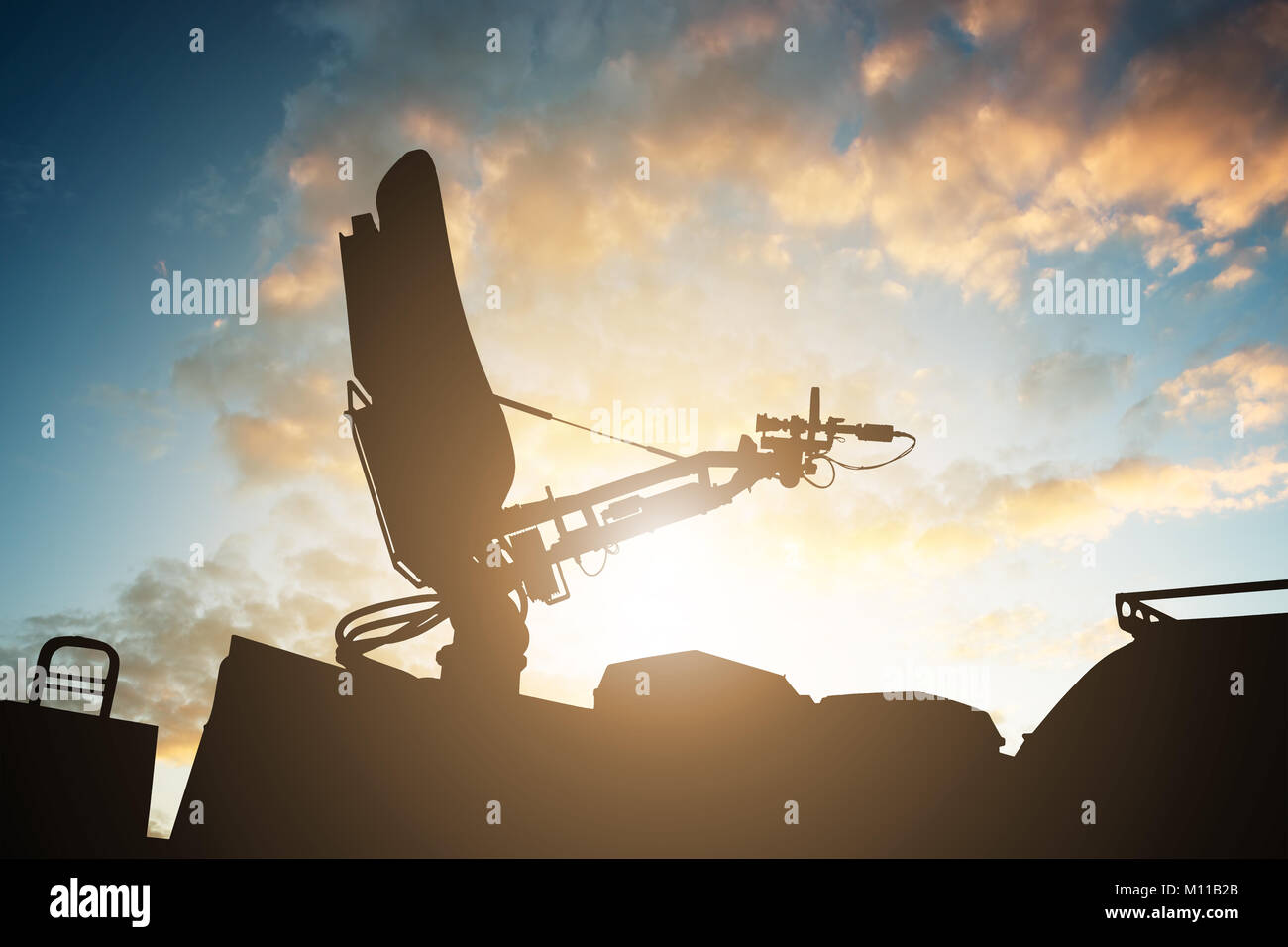 795c0fd571 Silhouette Of Satellite Dish Antenna On Top Of TV Van Against Sky - Stock  Image