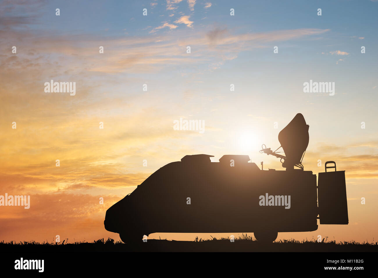 e67c49d4ae Silhouette Of TV News Truck Against Dramatic Sky At Sunset - Stock Image