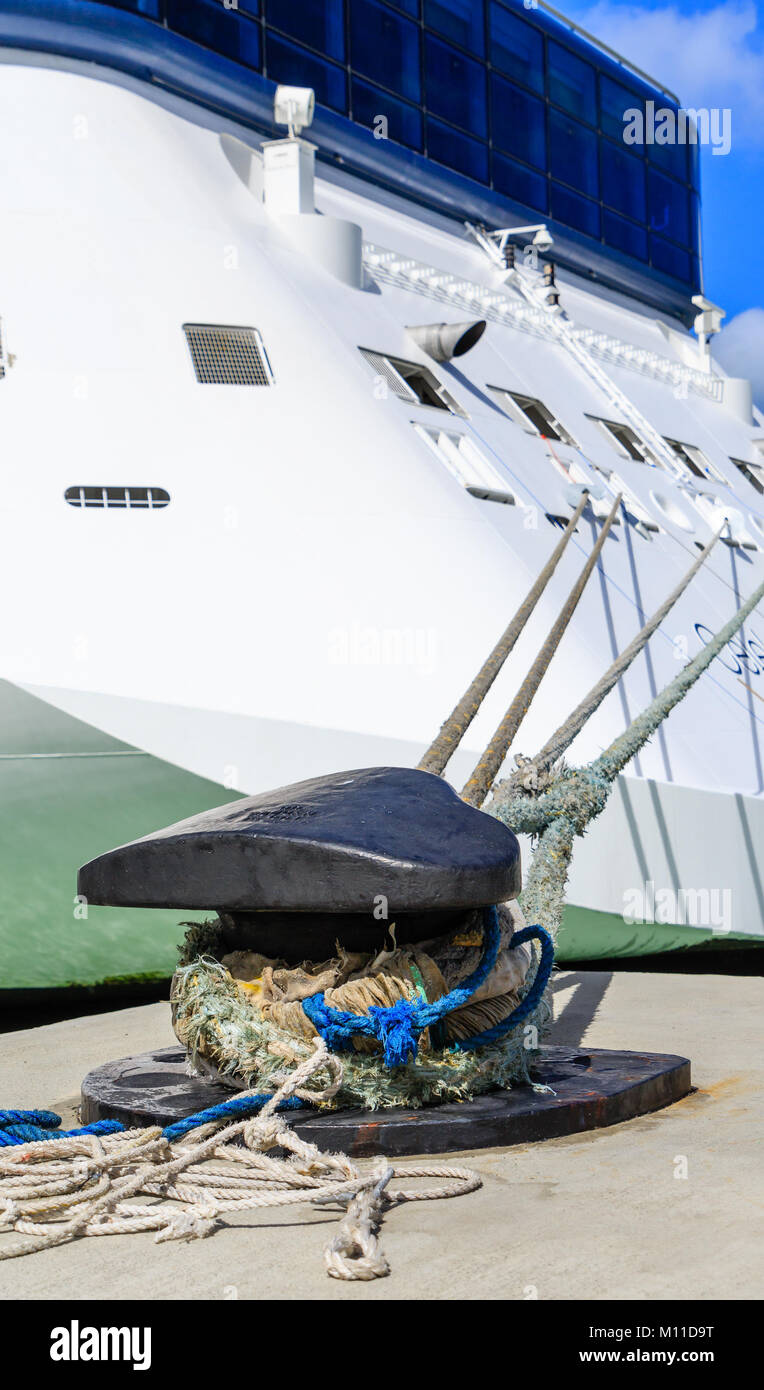 Ropes Tied From Bollard to Luxury Cruise Ship - Stock Image