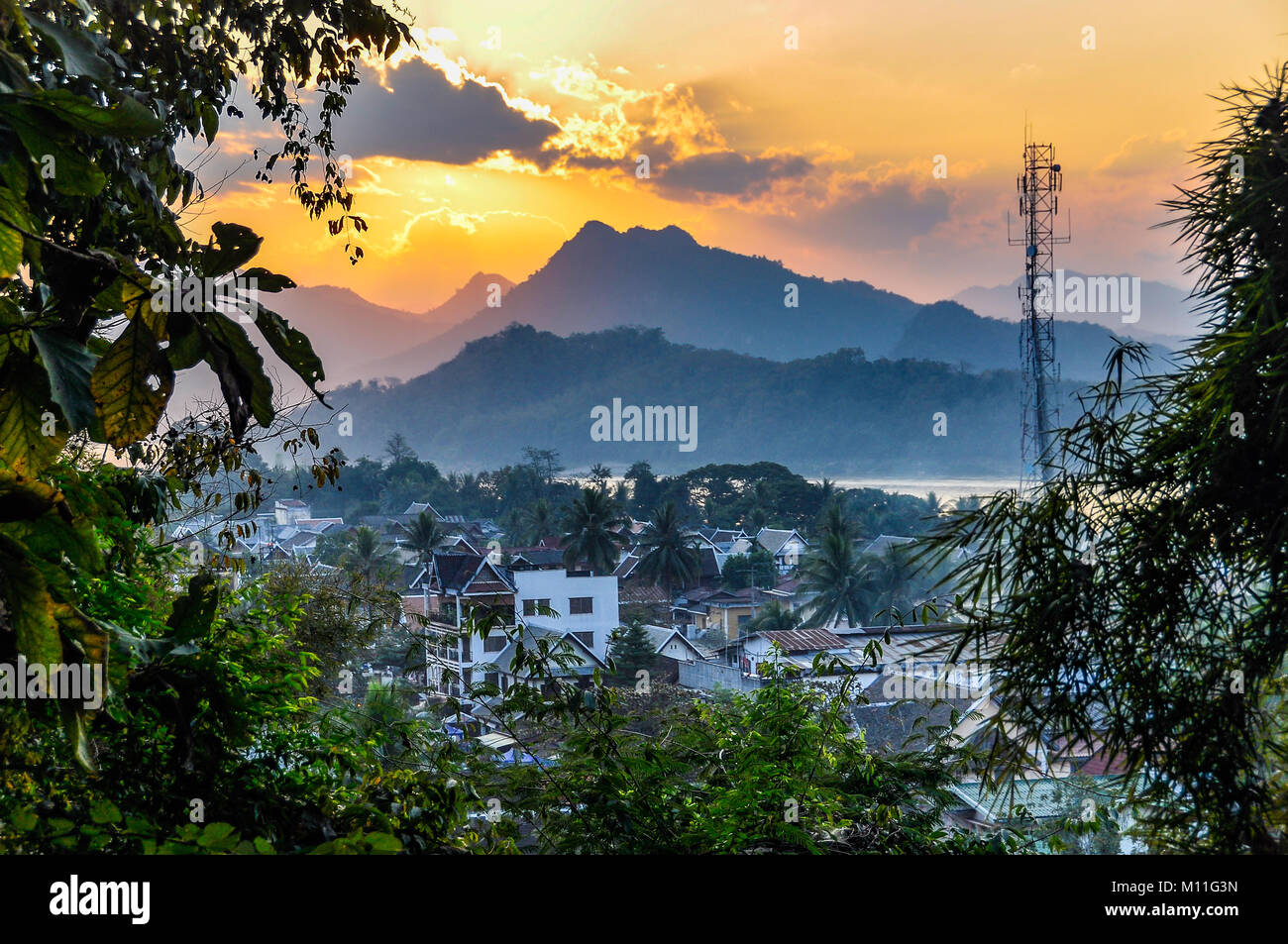 Sunset over UNESCO World Heritage Luang Prabang, Laos - Stock Image