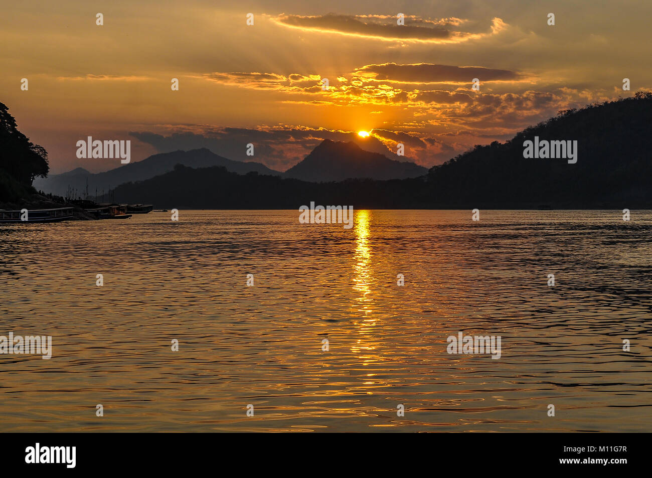 Sunset on the Mekong River in UNESCO World Heritage Luang Prabang, Laos Stock Photo