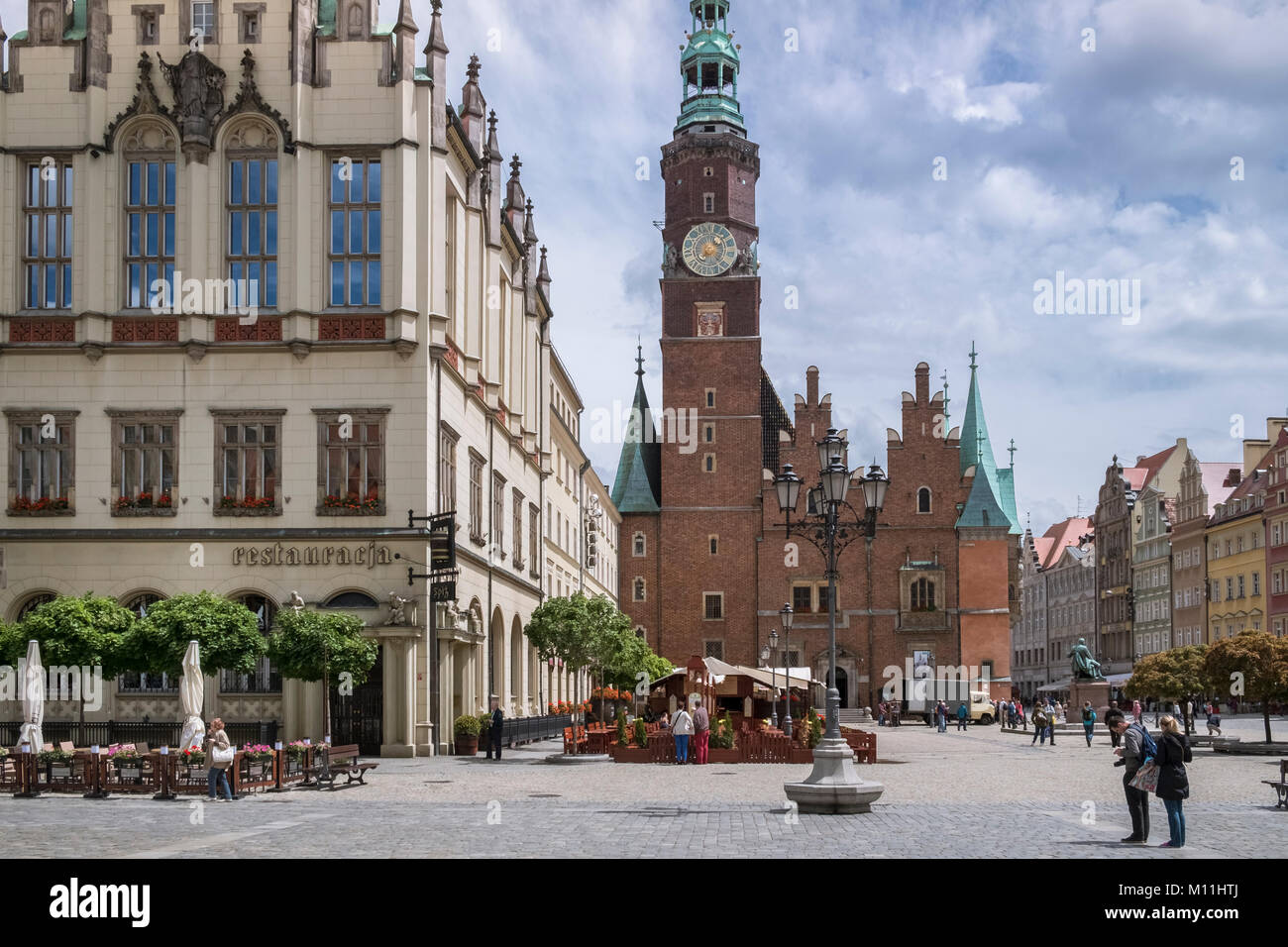 Traditional architecture in Wroclaw Old Town, showing west elevation of the Town Hall tower and clock, Wroclaw, Stock Photo