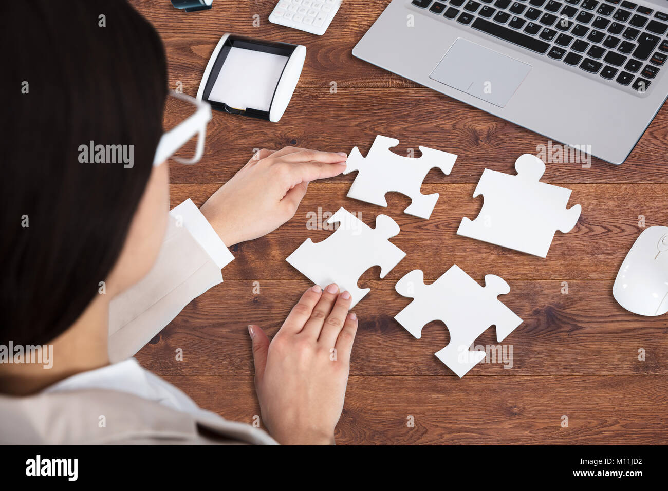 Jigsaw Puzzle Making Hand Stock Photos & Jigsaw Puzzle