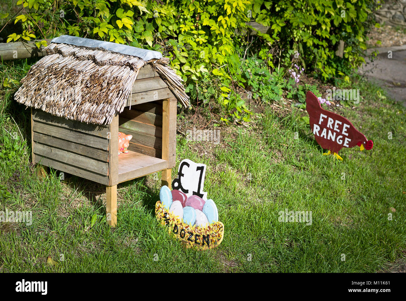 Point of self-service sale of surplus hens' eggs outisde a village private property in Wiltshire England UK - Stock Image
