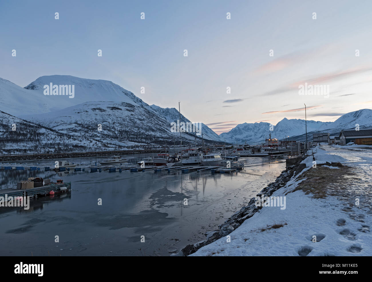 Boats in the sheltered harbor at Nord-Lenangen, Lyngen, Troms county, Norway Stock Photo